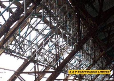 Beams to aircraft hangar scaffolding